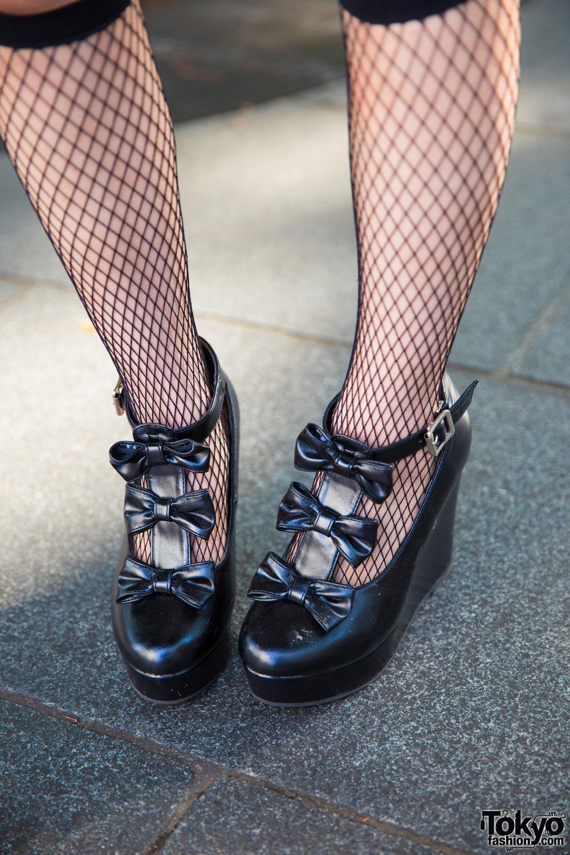 harajuku girl in plaid dress fishnet socks amp platform bow