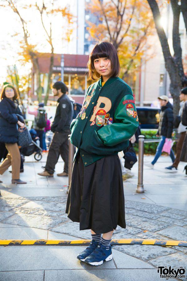 Musician Yuriko Sakurai in Chic Pink House Varsity Jacket, Cune Skirt, I Am I Tote & Reebok Sneakers