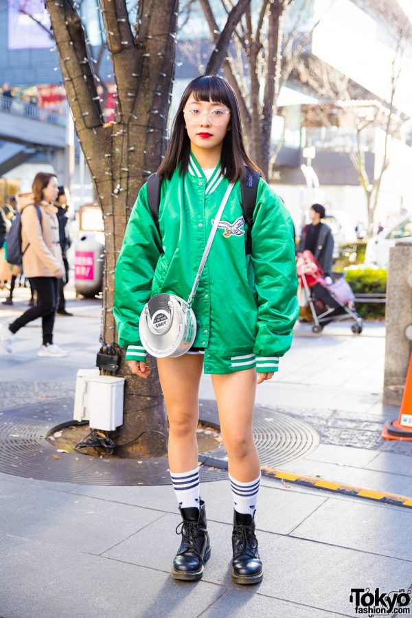 Harajuku Girl Sporty Chic in Green Bomber Jacket, Stussy Top, Moussy Bag & Dr. Martens Boots
