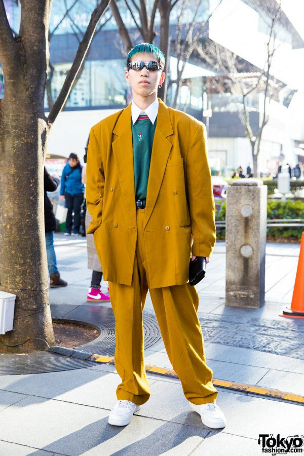 Green-Haired Blanco Hairstylist in Vintage Tan Suit, Opening Ceremony Top, Nike Sneakers & Gucci Accessories