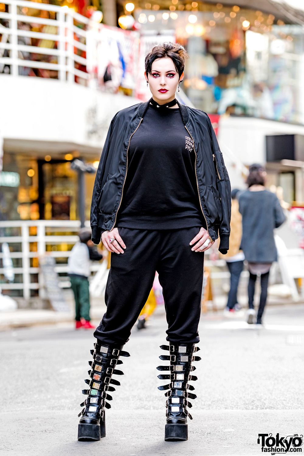 Photographer In All Black Harajuku Street Style W Evangelion Tee