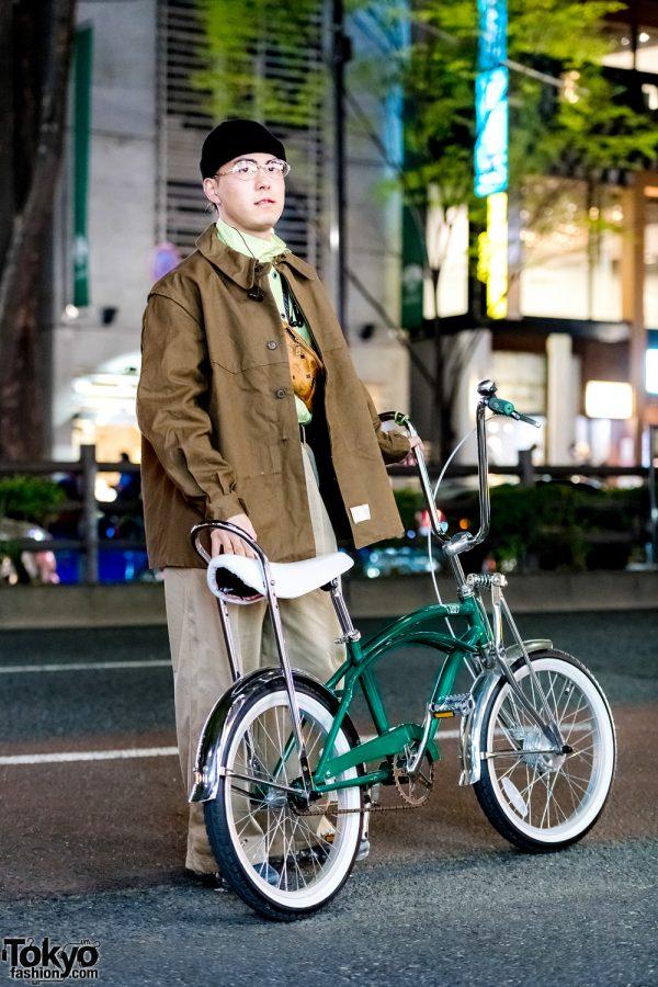 Harajuku Guy w/ Bicycle in Brown Jacket, Opening Ceremony Pants, MCM Bag & Nike Vapor Max Sneakers