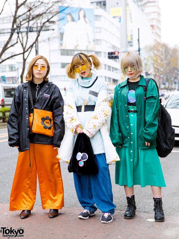 Harajuku Girl Trio Street Styles w/ Orange Satin Pants, Dress Over Pants, Green Midi Skirt & Colored Sunglasses
