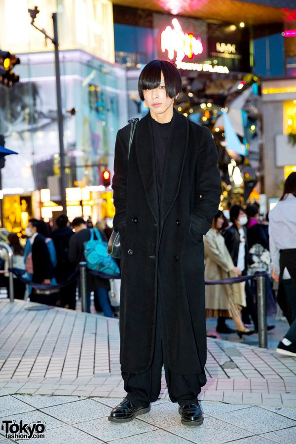 Japanese Art Designer in All Black Menswear Look w/ Christian Dior Coat, Kujaku Parachute Pants, George Cox Shoes & Gucci Sling
