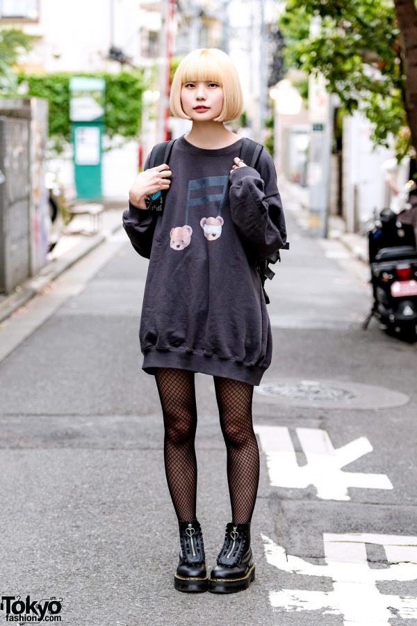 Japanese Designer in Oversized Candy Stripped Teddy Bear Sweatshirt, Dr. Martens Boots & Backpack