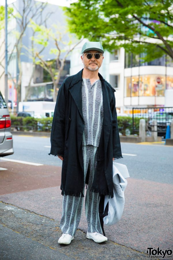 Micro-Pleat Monochrome Street Style w/ Fringed Coat, White Sneakers, Backpack & Pleated Cap