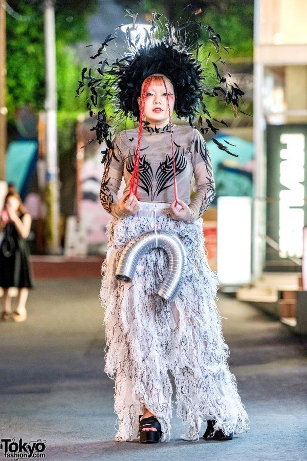 Avant-Garde Harajuku Street Style w/ Dolls Kill Tattoo Print Top, Remake Furry Pants, Platform Sandals & Feather Headdress