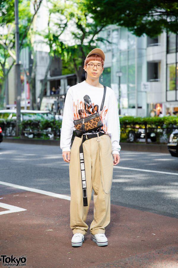 Japanese Videographer w/ Graphic Sweatshirt, Vintage Tan Pants, Animal Print Bag, Tan Hat & White Sneakers in Harajuku
