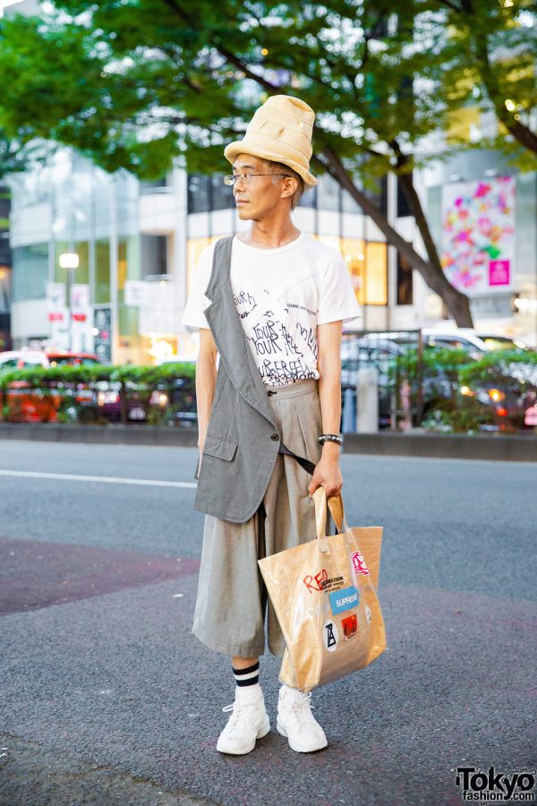 Comme des Garcons Harajuku Street Style w/ Tall Tan Hat, White Graphic Tee, Wide-Leg Pants & White Sneakers