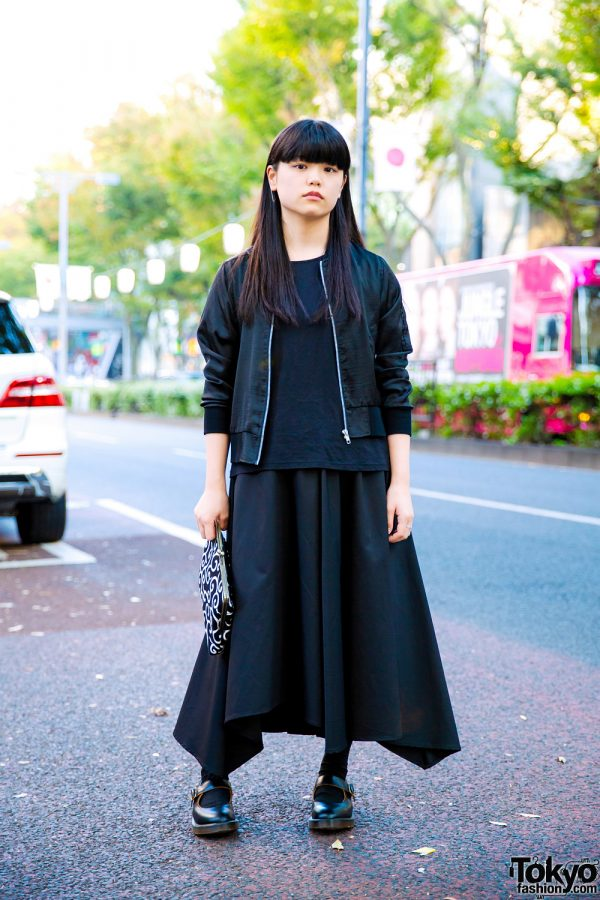 All Black Minimalist Street Style w/ Patterned Clutch, Heather Jacket, Uniqlo Top, Jeanasis Asymmetrical Skirt & Dr. Martens Mary Jane Shoes