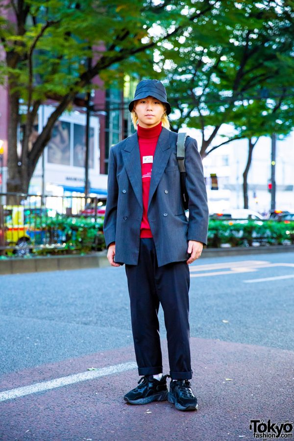 Casual Menswear Street Style w/ Bucket Hat, Geometric Earrings, Xander Zhou Turtleneck Top, Acne Studios Sneakers & Prada Sports Bag