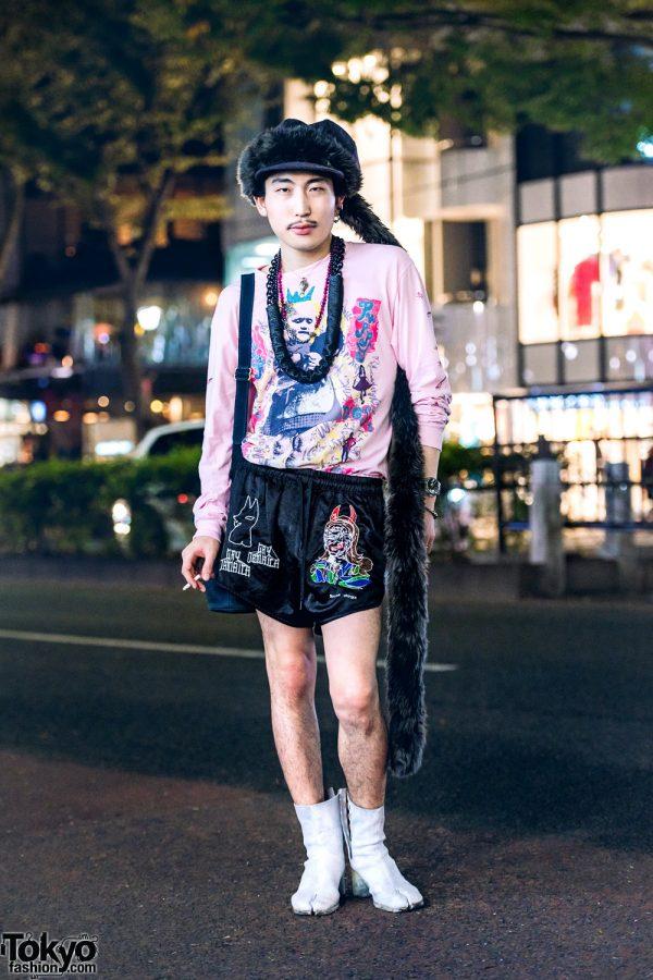 Japanese Artist in Statement-Making Streetwear Style w/ Blue Roses Graphic Sweater, Bernhard Willhelm Shorts, Maison Margiela Tabi Boots, Coach Bucket Bag & Gem Kingdom Accessories