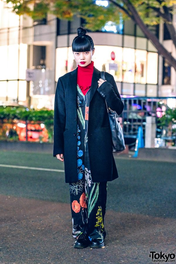 Nylon Japan Blogger in Chic Streetwear Style w/ UNIQLO Coat, Ahcahcum.Muchacha Floral Jumpsuit, Turtleneck, Coach Leather Tote & Dr. Martens