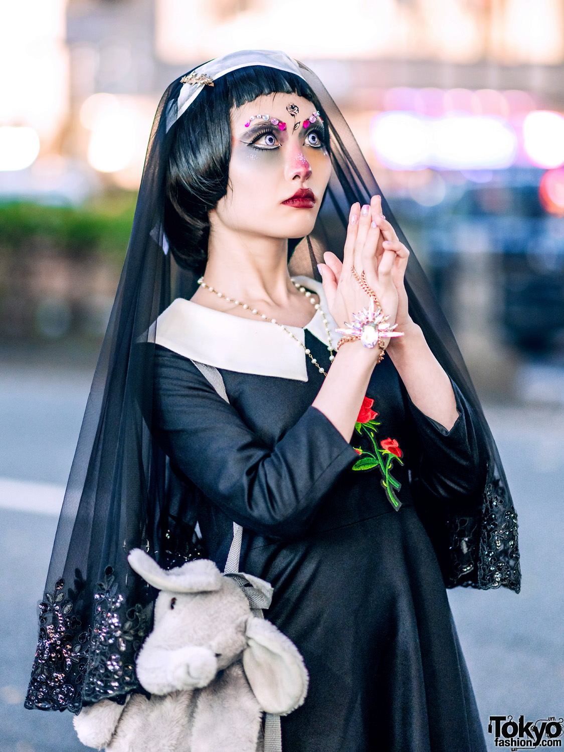 Japanese Creator in Gothic Harajuku Street Style w/ Doll Makeup, Face Jewels, Sheer Veil & Elephant Backpack