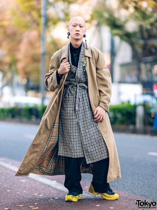 Japanese Model & Musician in Layered Outerwear Street Style w/ Burberry Coat, Plaid Liner, Face Shirt & Raf Simons Sneakers