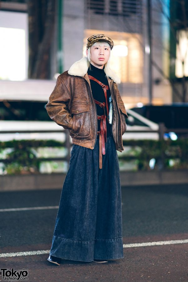 Tokyo Vintage w/ Printed Newsboy Cap, Leather Harness, Shearling Jacket, Jean Paul Gaultier Turtleneck, and Sea Wide-Leg Pants