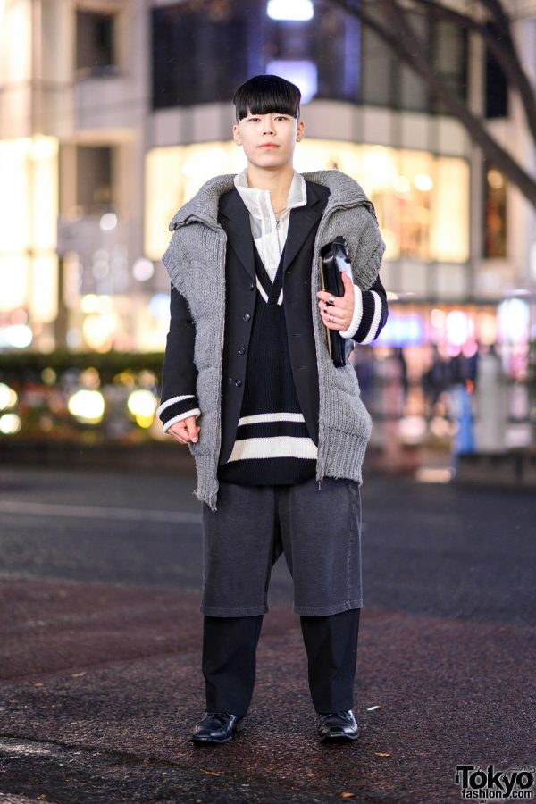 Tokyo Monochrome Layered Street Style w/ Oversized Collar Knit Vest, Blazer, Shorts Over Pants, Leather Lace-Up Loafers & Envelope Clutch