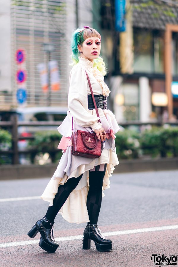 6%DokiDoki Staffer in Chic Ruffle Street Fashion w/ Colored Hair, Red Eye Makeup, Belted Corset, 6D High Low Tiered Skirt, Vivienne Westwood Sling & Disturbia Clothing Platforms