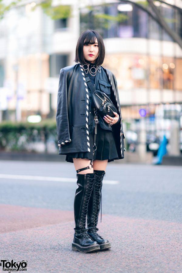 All Black Harajuku Streetwear Style w/ Fringed Bob, O-Ring Choker, Faux Leather Coat, Utility Vest, Pleated Skirt, Waist Bag & Thigh High Boots