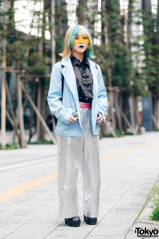 Fashion Student with Aqua-Streaked Hair, Black Lipstick, Shield Visor Sunglasses, Oh Pearl Satin Blazer, RRR Metallic Pants, Drawstring Backpack & Patent Platforms