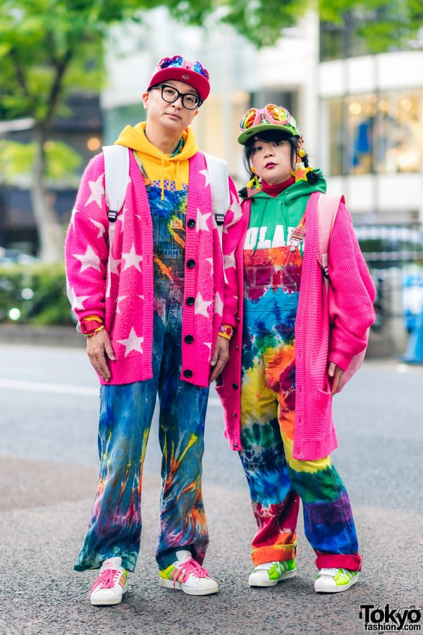 Colorful Harajuku Married Couple Street Fashion w/ Heart Goggles, Tie Dye Overalls, Joyrich Cardigans, New Era, Galaxxxy x Sega Dreamcast Backpack, Adidas & 6%DokiDoki