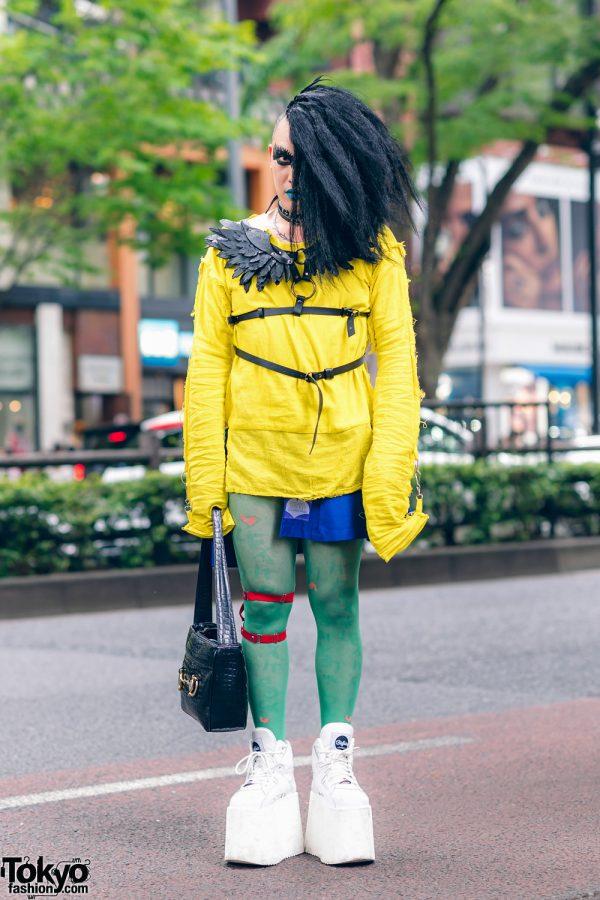 Japanese DJ, Vintage Fashion Buyer & Model in Harajuku w/ One Side Hairstyle, GILA Choker, Winged Harness, Jimsinn Pleated Skirt, Sheer Tights & Buffalo Platform Sneakers