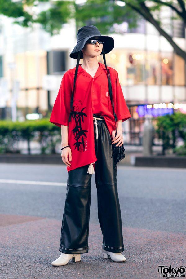 Japanese Fashion Designer & Rapper in Harajuku w/ Bucket Hat, Geometric Sunglasses, Tiger Print Shirt, Faux Leather Pants, Tasseled Belt & Heeled Boots