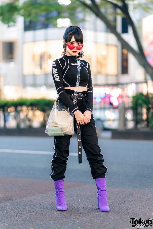 Japanese Idol in KL Alien Crop Top, Striped Track Pants, Clear Bag & Purple Sock Boots in Harajuku
