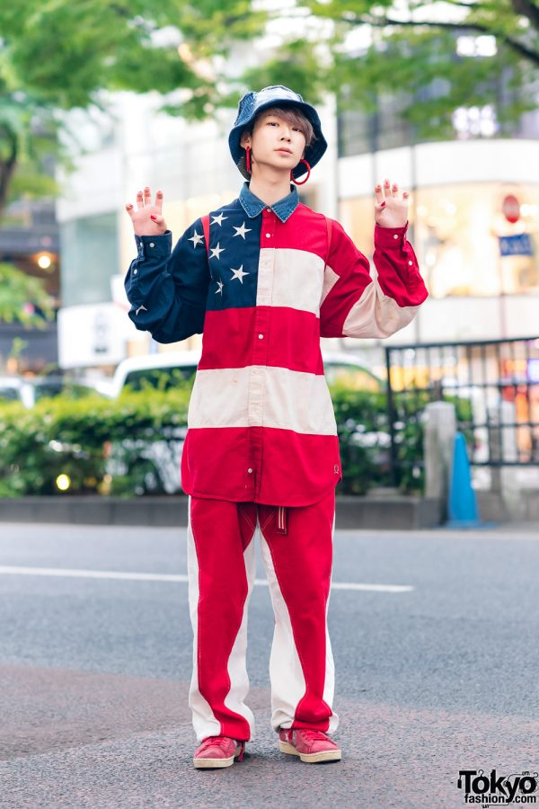 Americana-Themed Streetwear Style in Harajuku w/ Denim Bucket Hat, Gallerie Hoop Earrings, Tommy Hilfiger Stars & Stripes Shirt, M&Ms Backpack & Converse Suede Sneakers