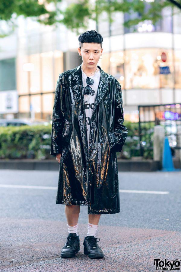 The Symbolic Tokyo Designer in John Lawrence Sullivan Shiny Coat, TST Shirt, Jil Sanders, Supreme & Nike Sneakers