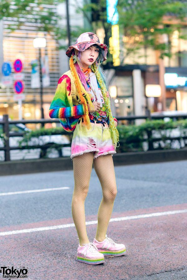 80s90s00sdolls Designer in Vintage Boho Street Fashion w/ Braided Hair Falls, Bucket Hat, Knit Vest, Tie Dye Shorts, Fishnets & Platform Sneakers
