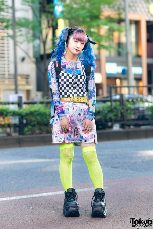 Harajuku Girl's Graphic Street Style w/ Blue Twin Tails, Checkered Top, Manga Skirt, Neon Fishnets, Sprayground Backpack & Demonia Platforms