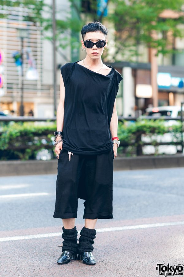 The Symbolic Tokyo Designer in All Black Rick Owens Streetwear Style w/ Asymmetrical Shirt, Cropped Linen Pants, Chrome Hearts Jewelry, Knit Legwarmers & Pointy Boots