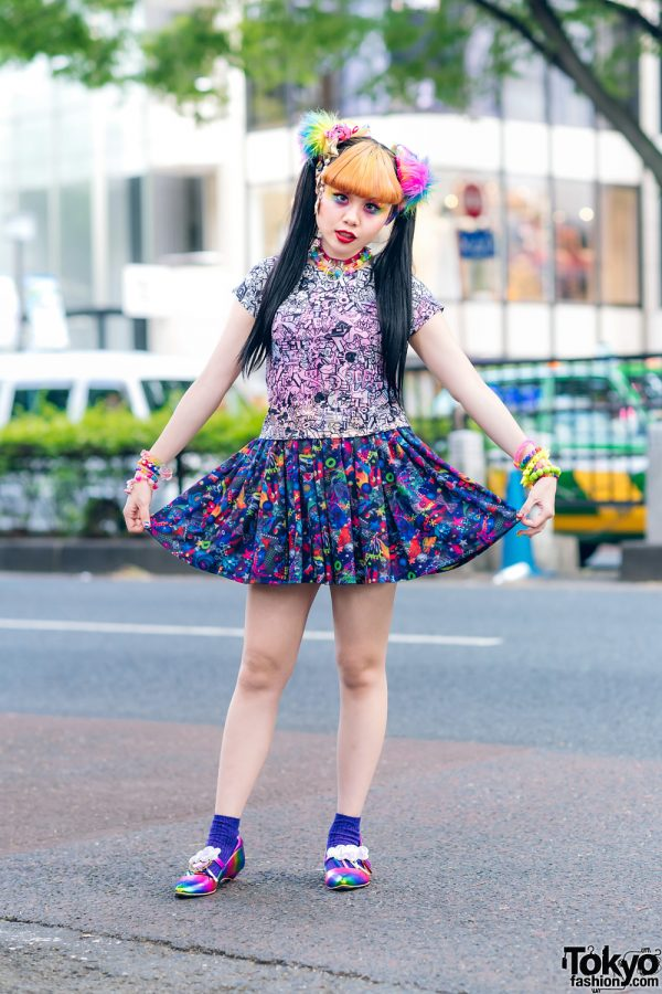 6%DokiDoki Kawaii Staffer w/ Twin Tails & Blonde Bangs, Rainbow Eye Makeup, Graphic Print Top, Kawaii Print Skirt, Claire's & IC Rainbow Shoes