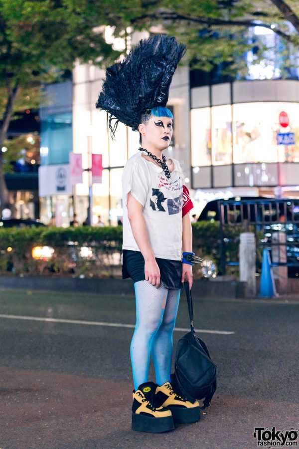 Tall Black Mohawk in Harajuku w/ Graphic Print T-Shirt, Blue Fishnet Stockings, Studded Bracelet, Buffalo Platform Shoes & MM6