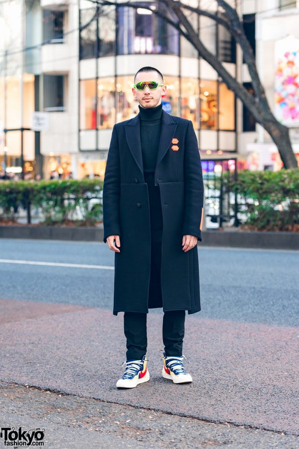 All Black Menswear Street Style w/ Prada Sunglasses, Off-White Long Coat, UNIQLO Turtleneck Sweater & Nike x Sacai Colorblock Sneakers