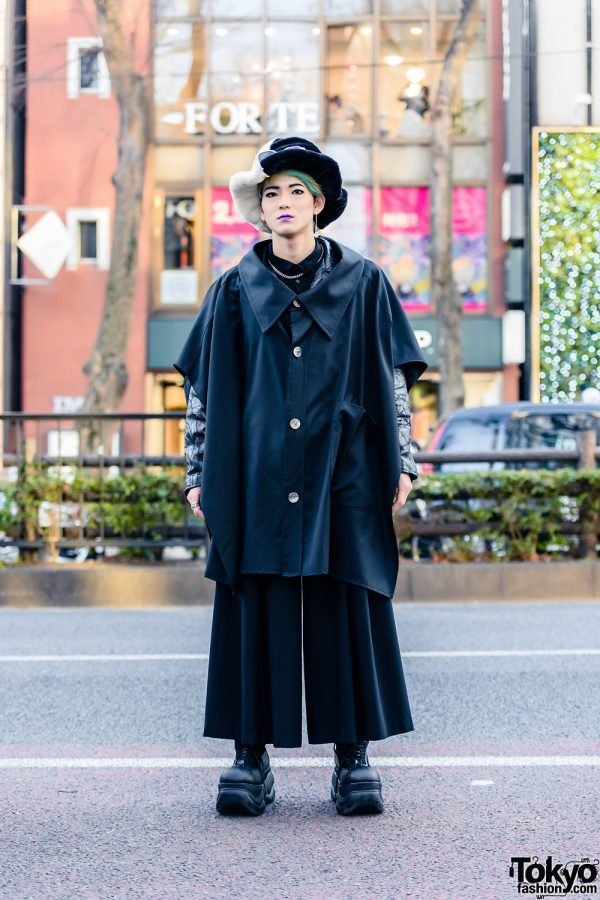 All Black Harajuku Street Style w/ Furry Two-Tone Hat, Mismatched Earrings, Anrealage Cape Coat, LAD Musician Wide Leg Pants & Demonia Platforms