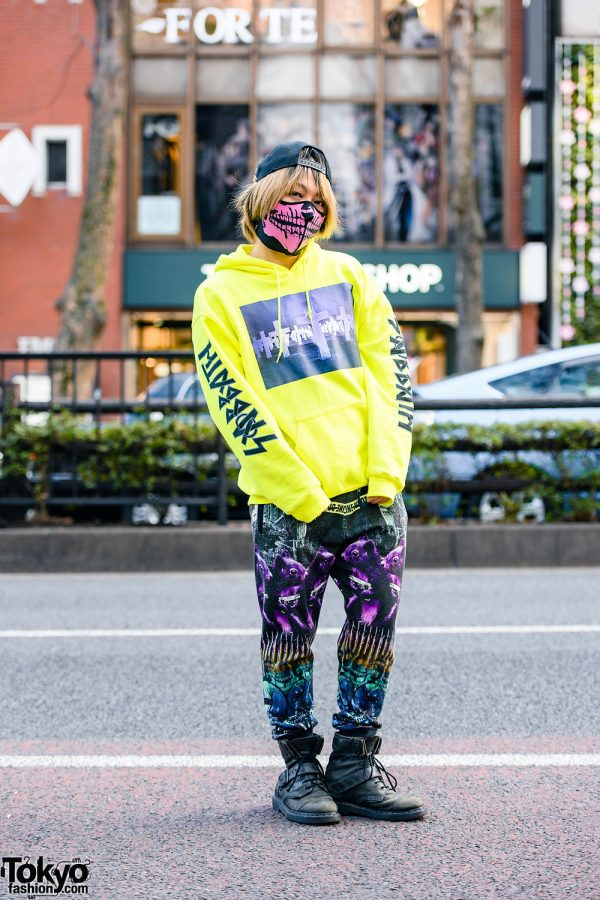 Japanese Pianist, Composer & DJ's Milkboy Graphic Streetwear Style w/ Studded Cap, Skull Mask, Hoodie Sweater, Graphic Print Pants & Dr. Martens Boots