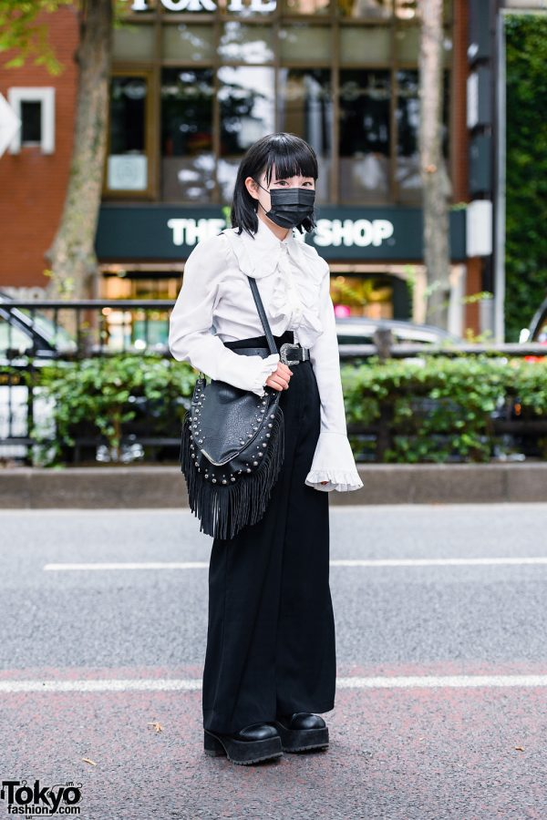 Minimalist Monochrome Street Style w/ Black Mask, Ruffle Shirt, Flared Pants, Fringed Shoulder Bag & Demonia Platform Boots