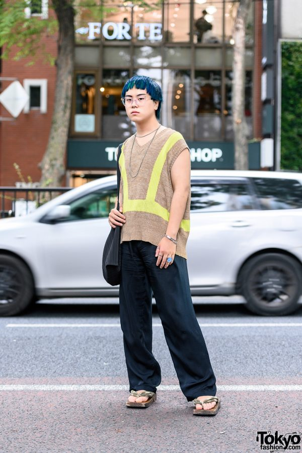 Harajuku Utility Streetwear Trend w/ Teal Hair, Sasquatchfabrix Sweater Vest, Eytys Drawstring Pants, Cartier, The Four-Eyed, Issey Miyake Accordion Bag & Geta Sandals