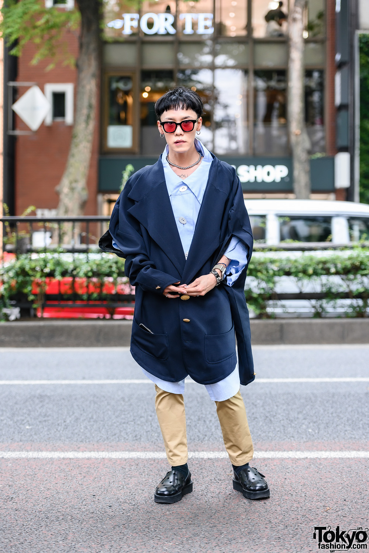 Anrealage Street Style w/ Tinted Sunglasses, Tattoo, Oversized Cutout Blazer, Oversized Shirt, Khaki Pants, Accessories & Cutout Clogs