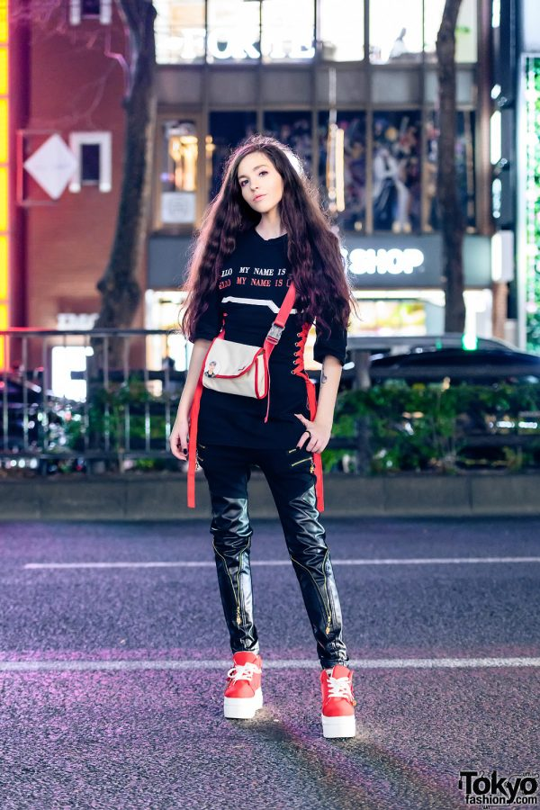 Black & Red Streetwear Look in Harajuku w/ Long Curly Hair, 3/4 Sleeve Corset Top, Skinny Leather Pants, Crossbody Bag & Platform Sneakers