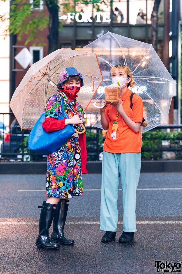 Tokyo Girls w/ Kobinai Mask, Umbrellas, Bucket Hat, Wraparound Dress, Comme des Garcons, Handmade Rings, Loaf of Bread & Hunter Rain Boots