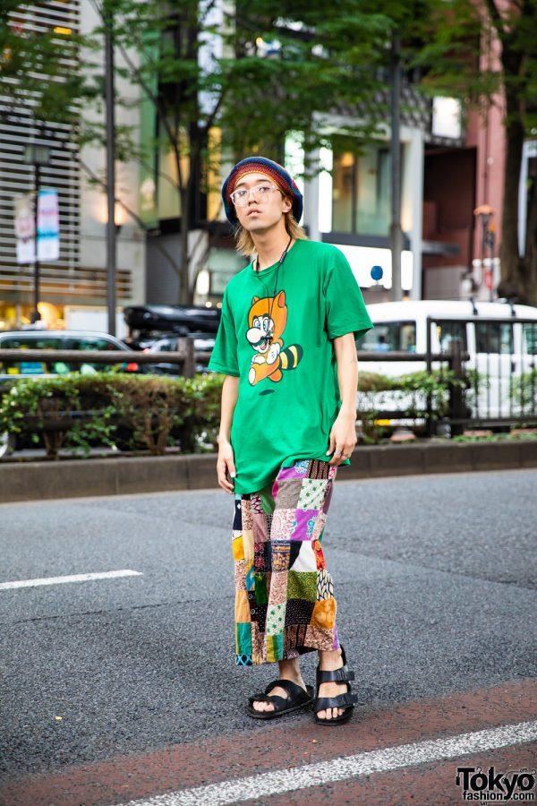 Apparel Designer in Vintage Boho Style w/ Super Mario Shirt, Vintage Patchwork Pants, Birkenstock Sandals, Crochet Beret Hat & Bronze Rings