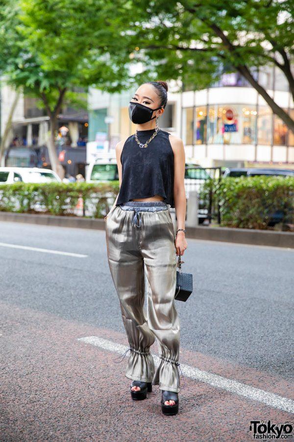 Chic Japanese Streetwear Style w/ Sleek Bun, Two-Tone Jewelry, Satin Mask, Juemi Shininess Code Pants, Yello Snakeskin Box Bag & Envym Peep-Toe Sandals