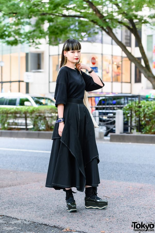 Fashion Designer in All Black Outfit w/ Black Shirt, Ujoh Tiered Long Skirt, Paloma Barcelo Wedge Shoes & Toga Accessories