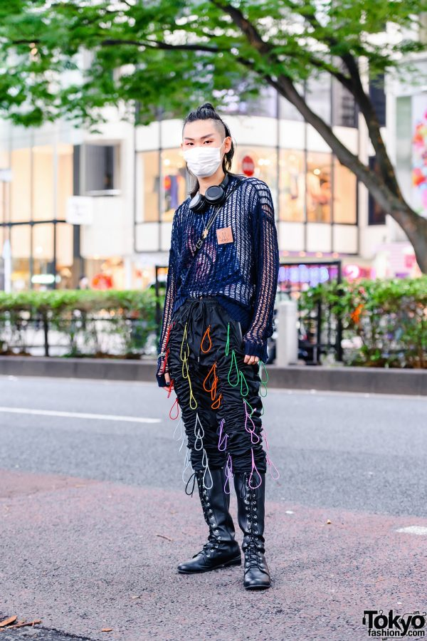 Harajuku Student w/ Top Knot Hairstyle in M.Y.O.B Loose Knit Sweater, EPTM Gather Pants, Lace-Up Tall Boots & Who's Who Gallery Crossbody Bag