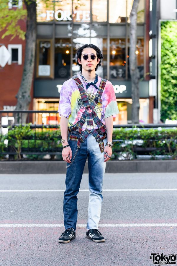 Student in Vintage Fashion w/ Body Harness, Round Sunglasses, Tie Dye Shirt, Levi's Jeans, Al's Attire Crossbody, Adidas Samba Classic Shoes, and Vintage Casio Watch
