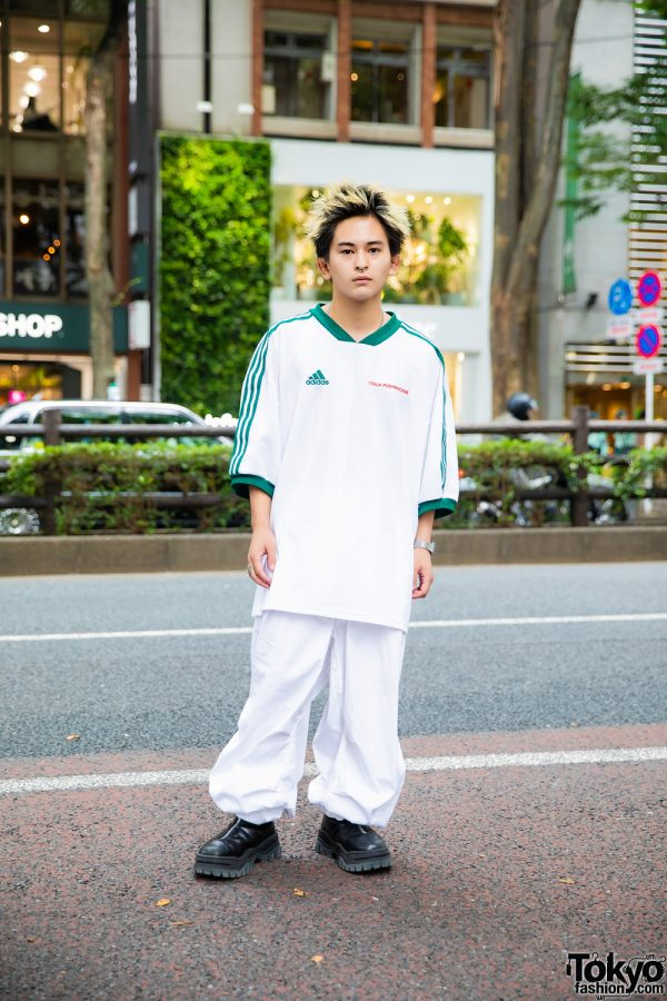 Student in Harajuku Sports Style w/ Septum Ring, Gosha Rubchinskiy X Adidas Football Shirt, US Snow Pants, Eytys Zippered Shoes & Vintage Accessories
