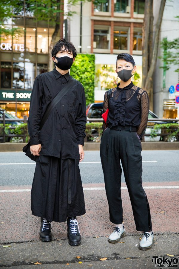 Japanese Duo All Black Street Styles w/ Undercut Hair, B Yohji Yamamoto, Sheer Polka Dot Blouse, Belted Trousers, Ground Y, Vivienne Westwood, Crazy Pig Designs, Chrome Hearts & Dr. Martens x Sex Pistols 1460 No Future Slogan Boots